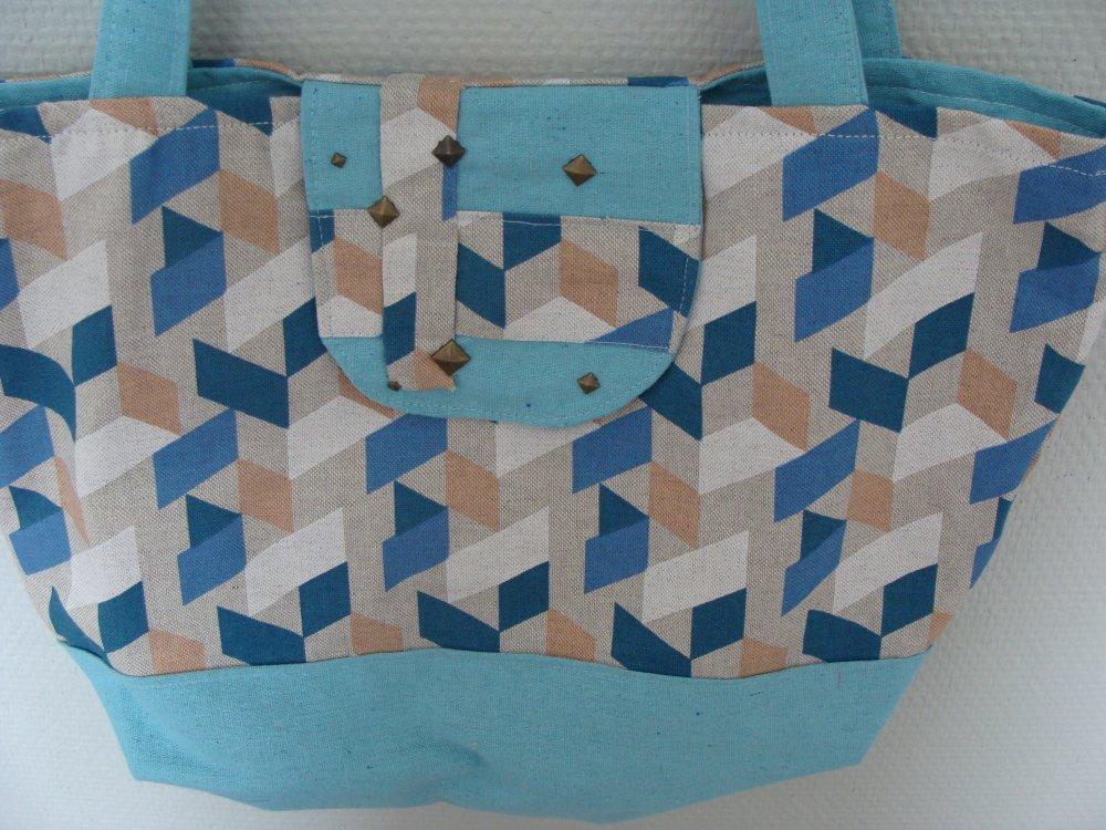 Sac cabas lin et jacquard cube géométrique rabat aimanté rivets