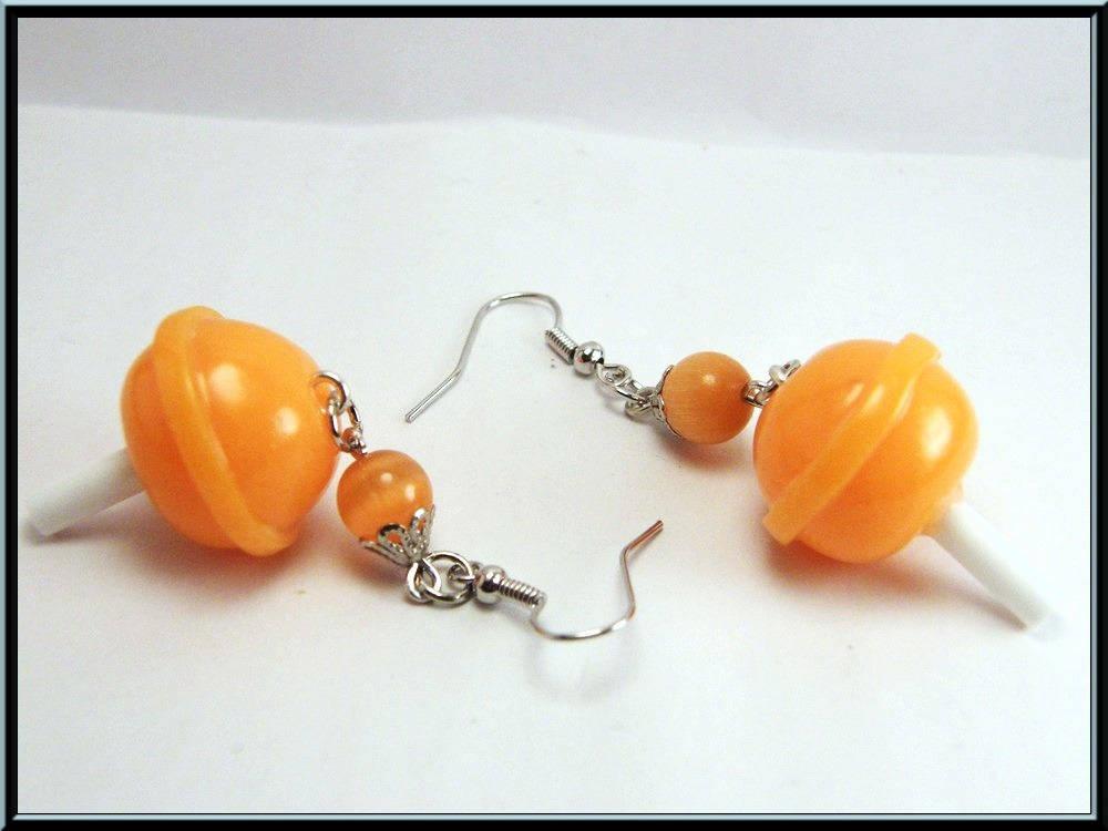 Boucles d'oreilles sucette à l'orange en Fimo.
