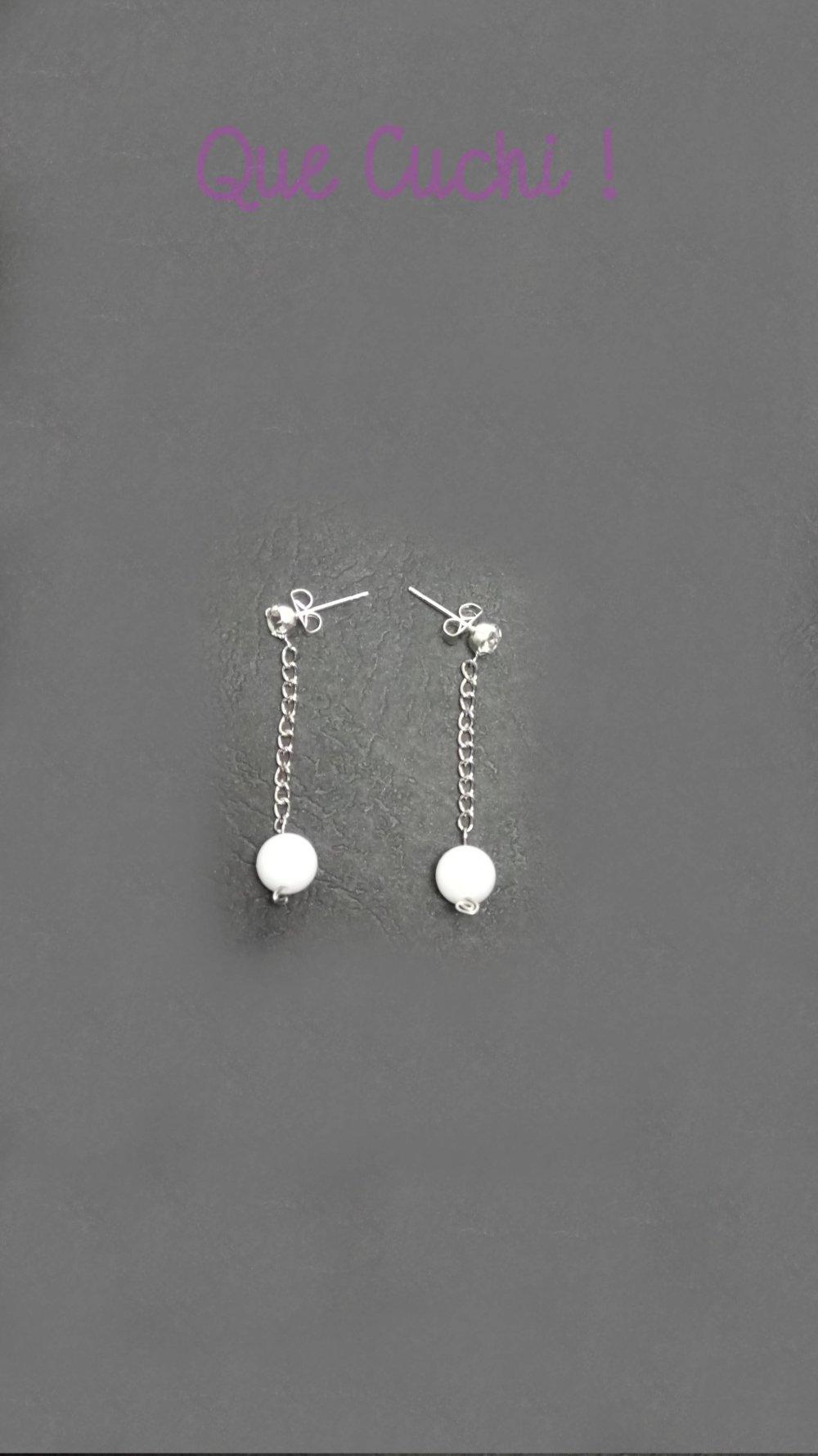 Boucles d'oreille long avec des perles de Nacre