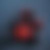 1 perle à facettes verre rouge et noire