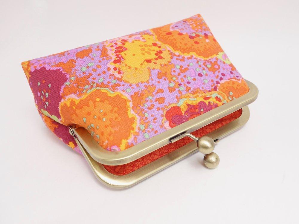 Trousse à fermoir en métal, tissu aux couleurs vives, orange, mauve et vert anis