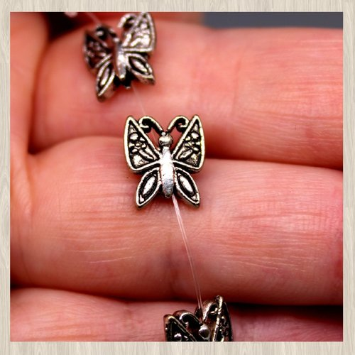 Lot de 5 perles en métal ou intercalaire papillon 10x9mm