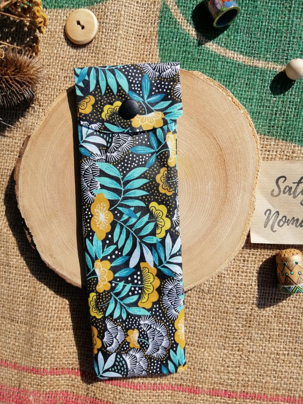 Pochette pour brosse à dent en chutes de coton enduit motif feuillage vert