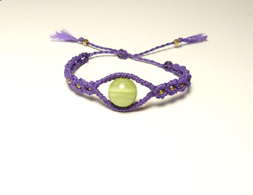 Bracelet forme oeil, macramé violet et perle verte en onyx marbre