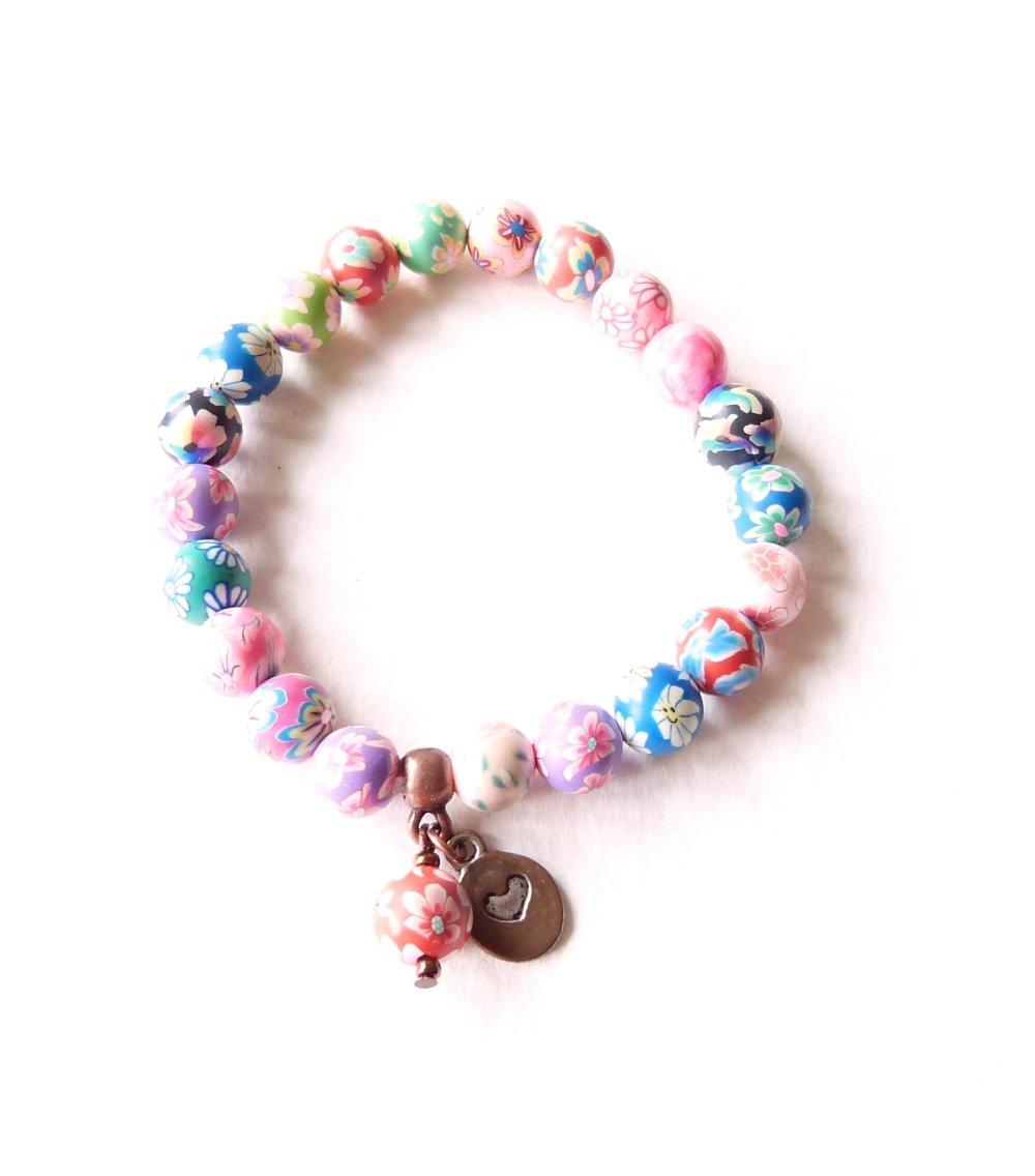 Bracelet perles fleuries en pâte polymère sur élastique