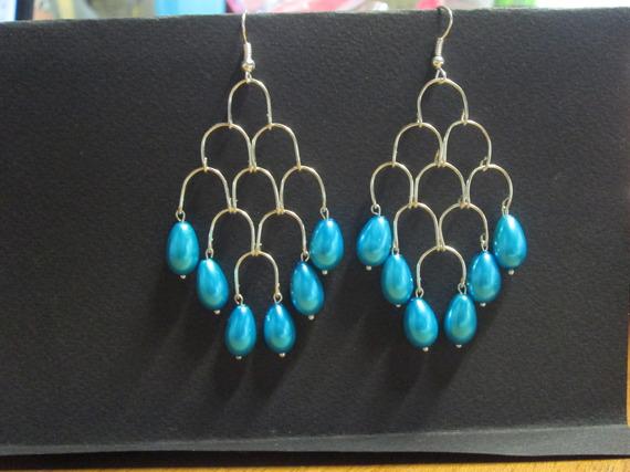 Boucle d'oreille perle satinée turquoise