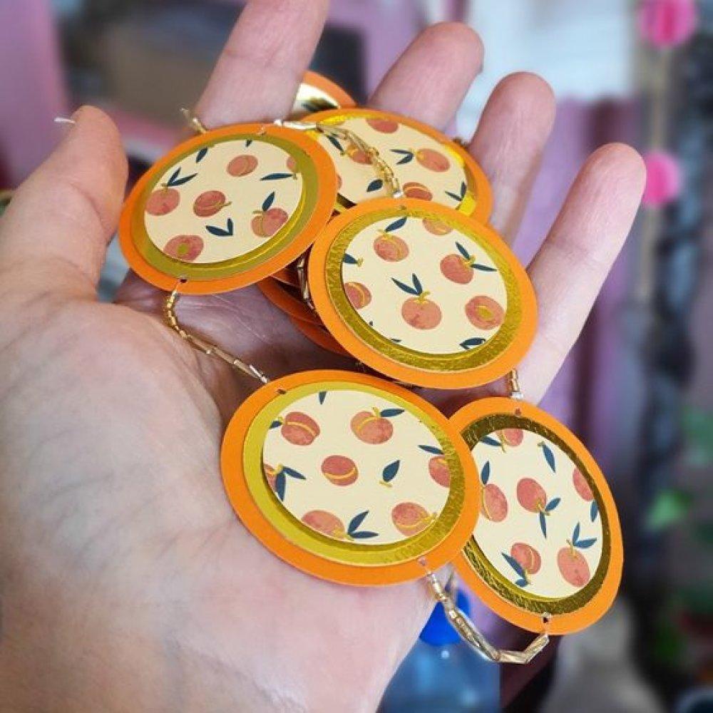 Guirlande plate ronds orange et papier imprimé fruits