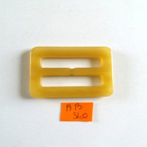 1 boucle coulissante en résine beige/jaune - 54x33mm - ab340