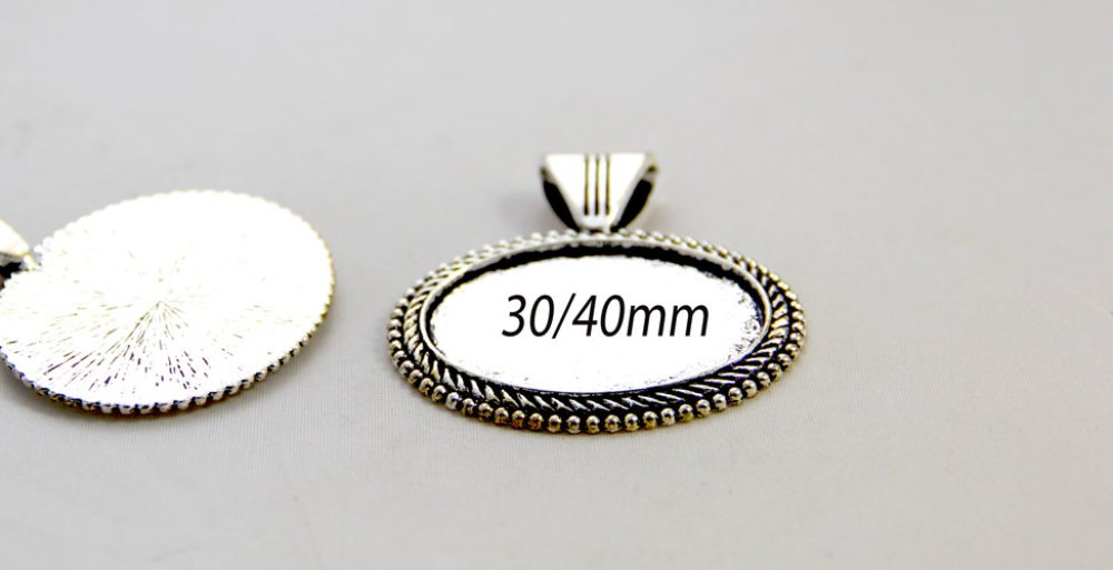 1 support pendentif avec beliére  cabochon ovale  30/40mm