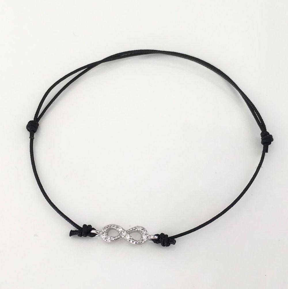 Bracelet infini en argent 925/000 et zirconium sur cordon noir ajustable