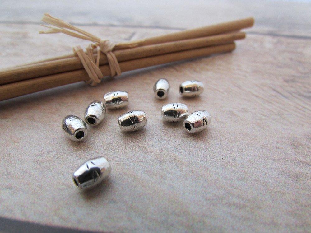 10 perles  tube en métal argenté - 6 x 4 mm - trou 2 mm -  629