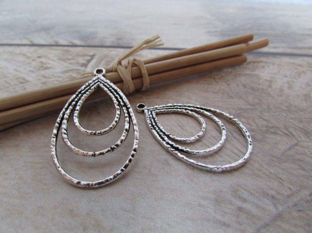4 Breloques 3.5 x 2 cm en métal couleur argenté  -trou 1.5 mm-  450.22