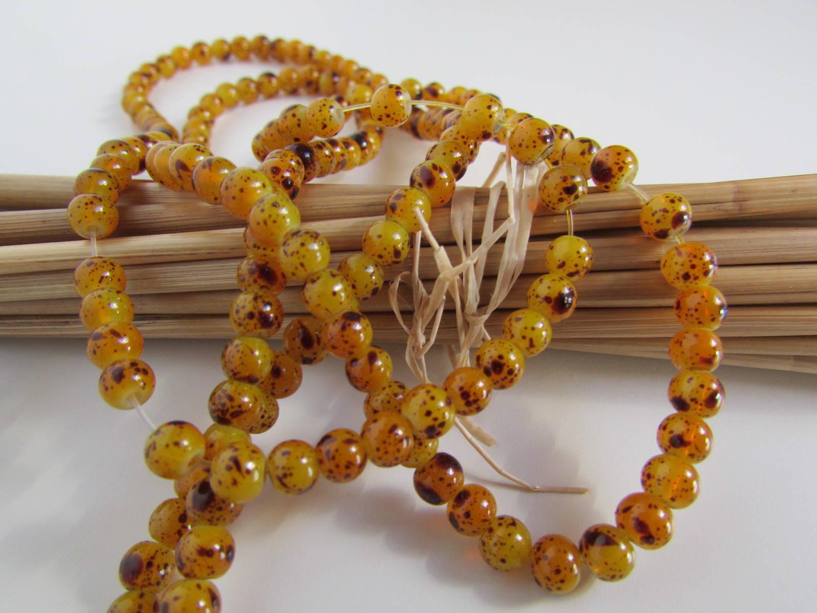 50 perles 4 mm en verre - jaune ocre zébré brun - trou 1 mm - ref 60.34