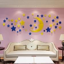 Sticker mural avec surface réfléchissante en forme de lune et d'étoiles